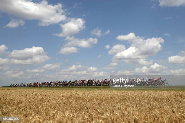 The peloton rides through the countryside during stage seven of the 2017 Le Tour de France a 2135km stage from Troyes to NuitsSaintGeorges on July 7...