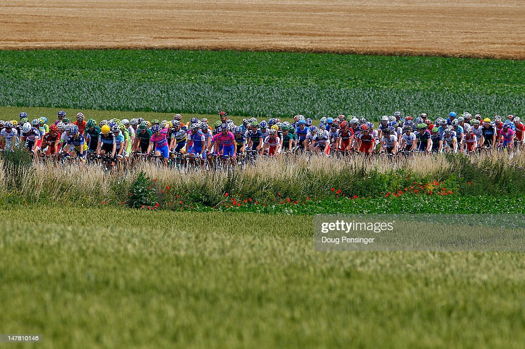 The peloton rides through the countryside during stage two of the 2012 Tour de France from Vise to Tournai on July 2, 2012 in Vise, Belgium.