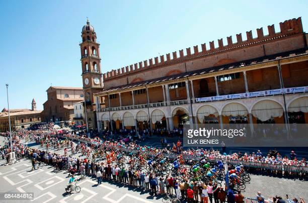TOPSHOT The peloton rides through the Faenza city during the 12th stage of the 100th Giro d'Italia Tour of Italy cycling race from Forli to Reggio...