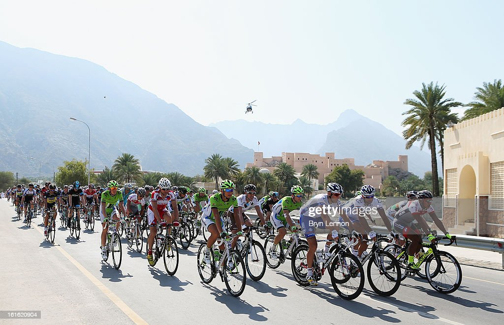 The peloton rides through the Oman countryside at the start of stage three of the 2013 Tour of Oman from Nakhal Fort to Wadi Dayqah Dam on February 13, 2013 in Nakhal Fort, Oman.