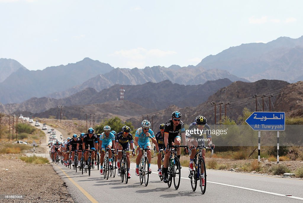 The peloton rides through the Oman countryside during stage four of the 2013 Tour of Oman from Al Saltiyah in Samail to Jabal Al Akhdhar (Green Mountain) on February 14, 2013 in Jabal Al Akhdhar, Oman.