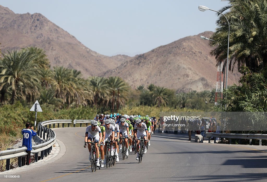 The peloton rides through the Oman countryside during stage two of the 2013 Tour of Oman from Fanja in Bidbid to Al Bustan on February 12, 2013 in Al Bustan, Oman.