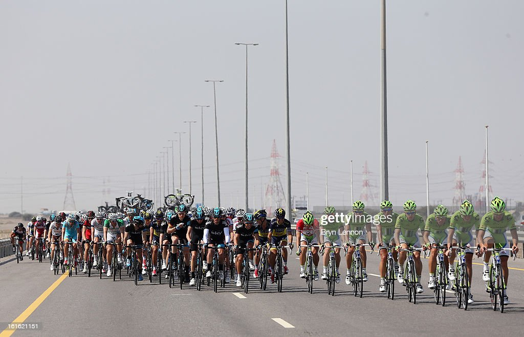 The peloton rides through the Oman countryside on stage three of the 2013 Tour of Oman from Nakhal Fort to Wadi Dayqah Dam on February 13, 2013 in Wadi Dayqah Dam, Oman.