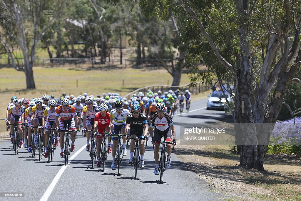 The peloton rides through the town of Handorf during the 116.5km stage two of the Tour Down Under in Adelaide on January 23, 2013. The six-stage Tour Down Under takes place from January 20 to 27. AFP PHOTO / Mark Gunter USE