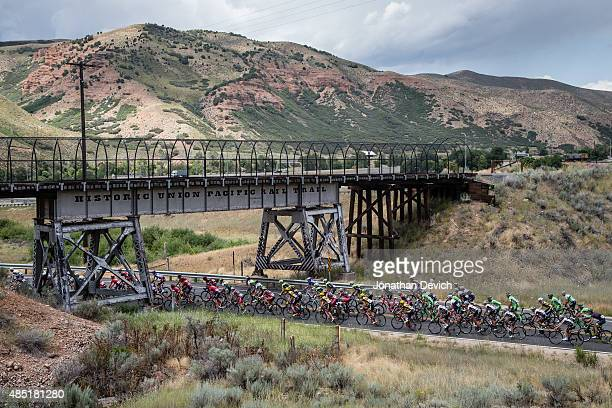 The peloton rides under a railroad overpass during stage 6 of the Tour of Utah on August 8 2015 in Salt Lake City Utah