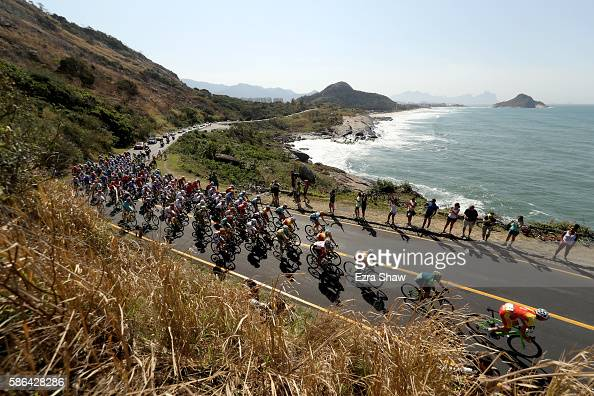 The peloton rolls through Grumari during the Men's Road Race on Day 1 of the Rio 2016 Olympic Games at the Fort Copacabana on August 6 2016 in Rio de...