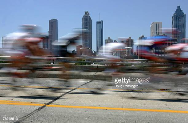 The peloton rolls through the streets of Atlanta during the final Stage Seven of the Tour de Georgia on April 22 2007 in Atlanta Georgia