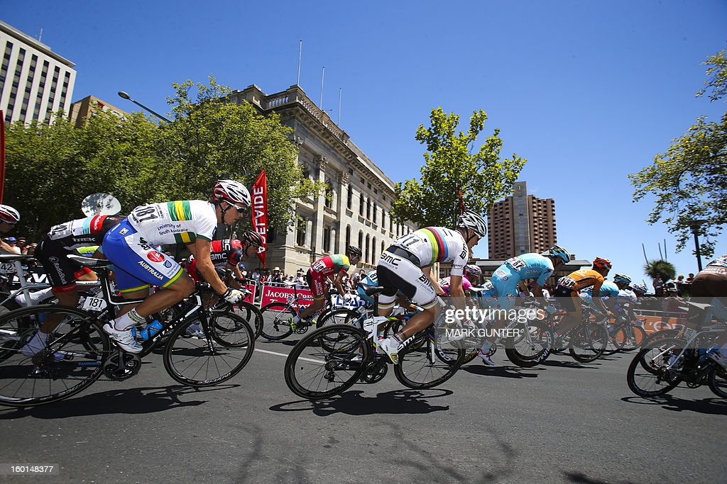 The peloton rounds a corner during the 90-km stage 6 around the streets of Adelaide on the final day of the Tour Down Under cycling race in Adelaide on January 27, 2013. AFP PHOTO / Mark Gunter USE