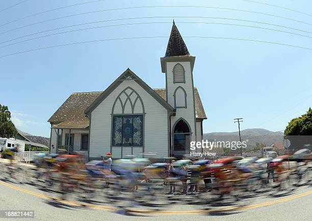 The peloton speed by Bardsdale United Methodist Church during Stage 4 of the Tour of California on May 15 2013 in Fillmore United States