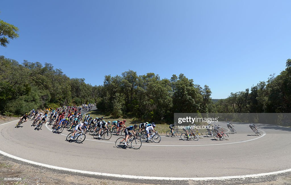 The peloton sweeps around a bend during stage four of the 2016 Herald Sun Tour cycling race at Arthurs Seat in Victoria on February 7, 2016. AFP PHOTO / MAL FAIRCLOUGH FAIRCLOUGH