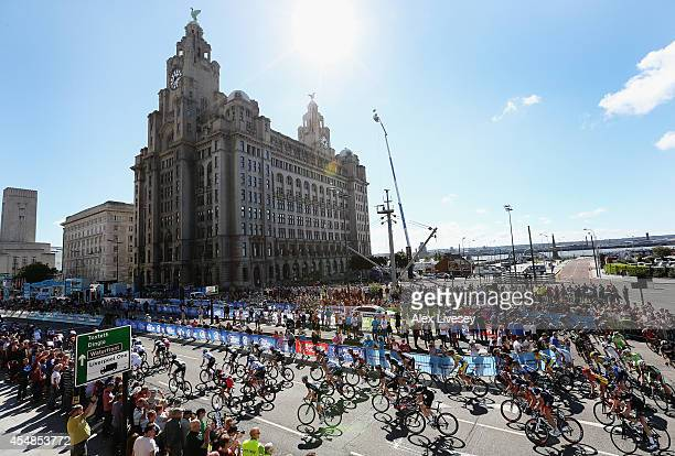 The peloton take a bend in front of the Liver Building on lap two during stage one of the Tour of Britain in Liverpool City Centre on September 7...