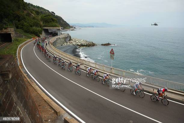 The peloton winds its way along the coast during the eleventh stage of the 2014 Giro d'Italia a 249km medium mountain stage between Collecchio and...
