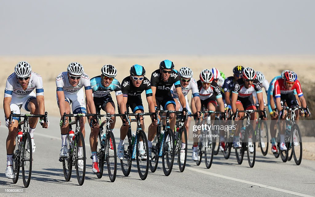The pelton battles strong cross winds on stage one of the 2013 Tour of Qatar from Katara Cultural Village to Dukhan Beach on February 3, 2013 in Dukhan Beach, Qatar.