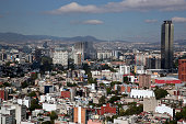 The Pemex Tower headquarters for the Mexican statecontrolled oil company Petroleos Mexicanos center stands above other buildings in the skyline in...