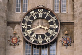 The pendulum clock which was installed in 1910 and stands in the great court of Trinity college Cambridge University Cambridge England circa 1990 The...