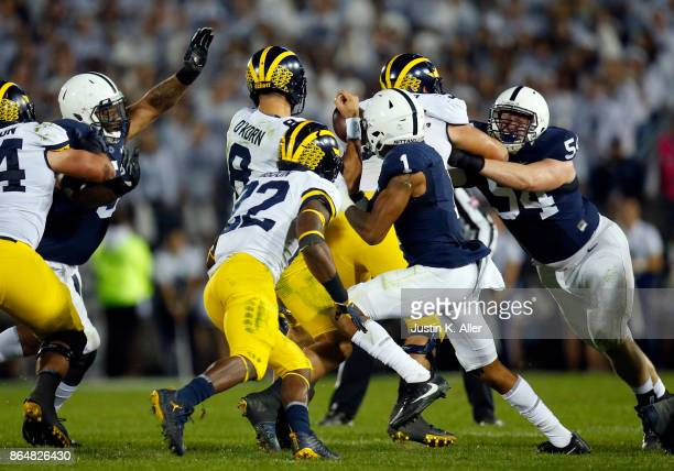 The Penn State Nittany Lions cause John O'Korn of the Michigan Wolverines to fumble in the second half on October 21 2017 at Beaver Stadium in State...