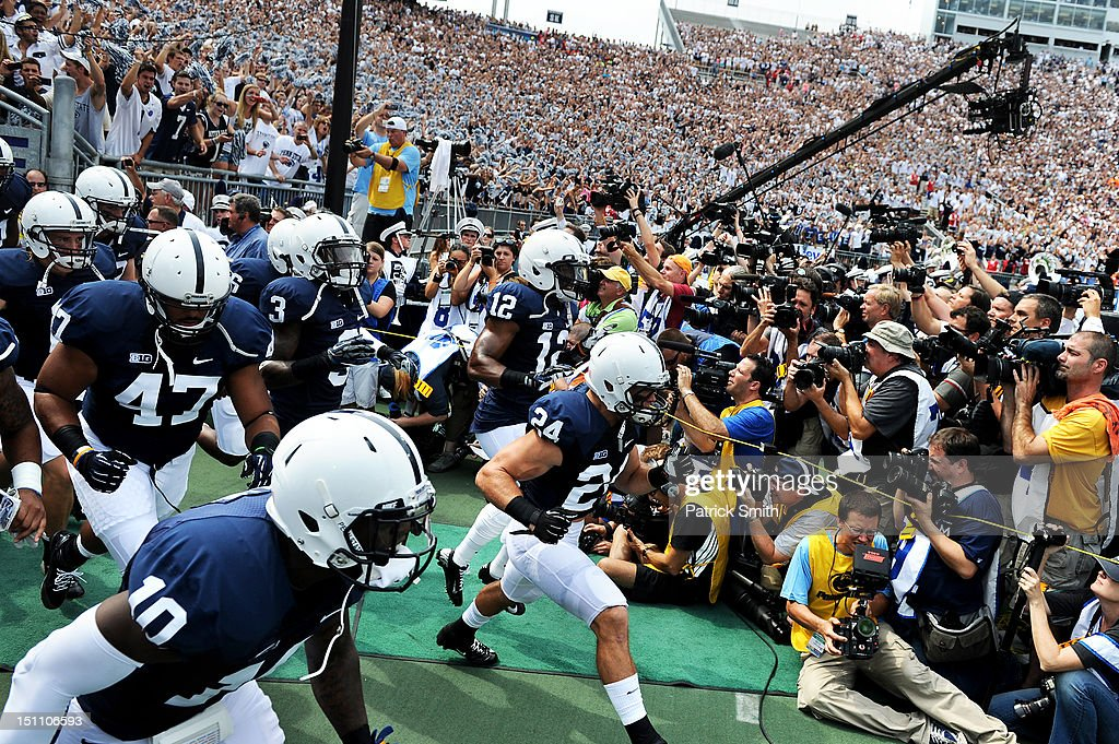 The Penn State Nittany Lions football team takes the field before playing the Ohio Bobcats at Beaver Stadium on September 1, 2012 in State College, Pennsylvania. Head coach Bill O'Brien is leading the Penn State football team for the first time since former coach Joe Paterno.