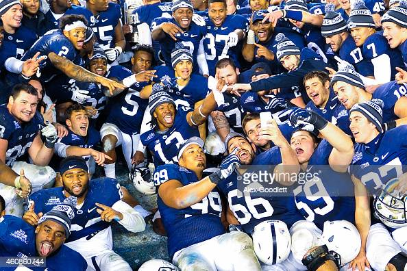 The Penn State Nittany Lions take a selfie after defeating the Boston College Eagles in the 2014 New Era Pinstripe Bowl at Yankee Stadium on December...