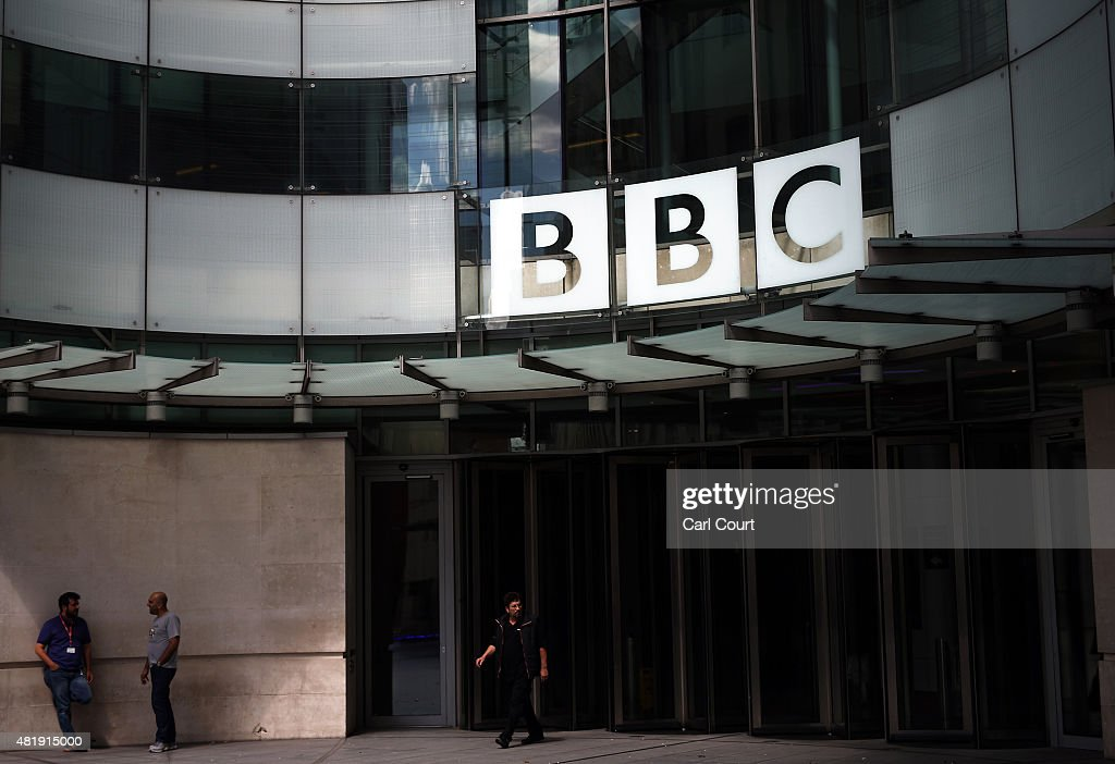 The people stand outside the Broadcasting House the headquarters of the BBC on July 25 2015 in London England The main Art Decostyle building of the...