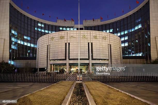 The People's Bank Of China headquarters stand at night in the financial district of Beijing China on Monday March 2 2015 China's yuan fell to the...