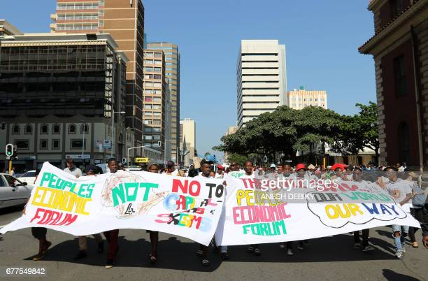 The People's Economic Forum supporters and activists hold banners as they march through the streets of Durban against State Capture and corruption...