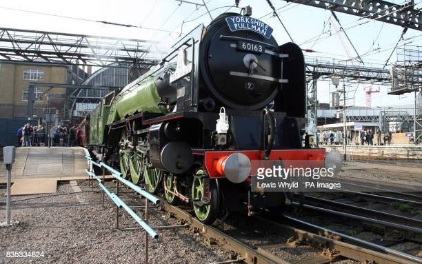 The Peppercorn class A1 60163 Tornado the first new steam locomotive to be built in Britain for almost 50 years leaves London King's Cross station...