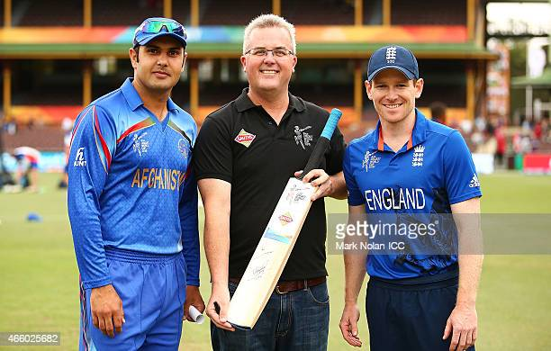 The Pepsi coin toss winner poses for a photo with Afghanistan captain Mohammad Nabi and England captain Eoin Morgan before the 2015 Cricket World Cup...