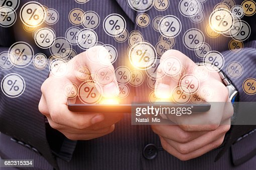 The percentage discount from the tablet. : Stock Photo