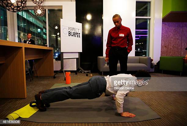 The Perfect Burpee intern Jeff Schwartz of Suffern NY demonstrates a burpee on The Perfect Burpee yoga mat at the first Boston Fitness Gala at...