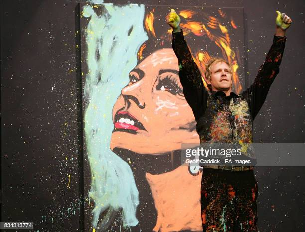 The performance artist Brian Olsen as he finishes painting a picture of Sophia Loren live onstage aboard cruise ship MSC Poesia at Dover christened...