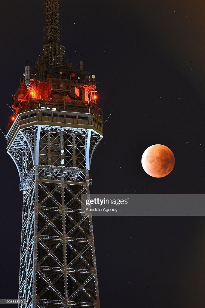 The perigee full moon, or supermoon is seen next to the Eiffel Tower on September 28, 2015 in Paris, France.