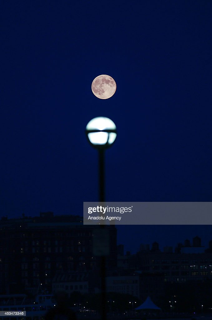 The perigee moon or 'supermoon' is seen on August 10, 2014 from New York, United States. Tonight's supermoon is the largest and closest full moon of the year. It is 14 percent closer and 30 percent brighter than other full moons of the year, according to NASA. The supermoon on Sunday was the second in a trio of supermoons this summer, with one having happened on 12 July and the next one due to appear on 9 September. To have three in such close proximity is very rare and it is not expected that this will happen again until 2034.