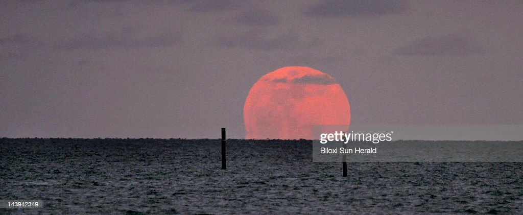 The Perigee Moon rises over the Mississippi Sound in Biloxi, Mississippi, on Saturday, May 5, 2012. This occurrence happens when the Moon is in its nearest approach to Earth.