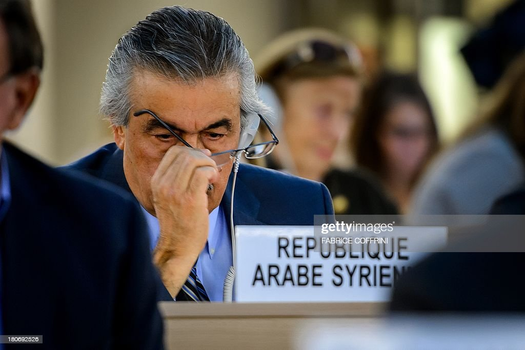 The permanent representative of the Syrian Arab Republic, Ambassador Faysal Khabbaz Hamoui, gestures on September 16, 2013 during the presentation of a report of the United Nations (UN) Commission of Inquiry on Syria before Human Rights Council's members in Geneva. Chemical weapons attacks are a war crime, a UN-mandated investigator told the world body's top human rights forum, slamming a litany of abuses in war-torn Syria.