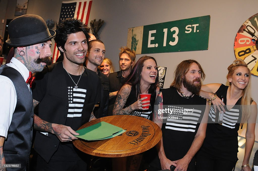 The Perri Ink Cartel receive an award from Jack Daniels Distillery at the PERRI INK. Cartel Store Opening on November 11, 2011 in Los Angeles, California.