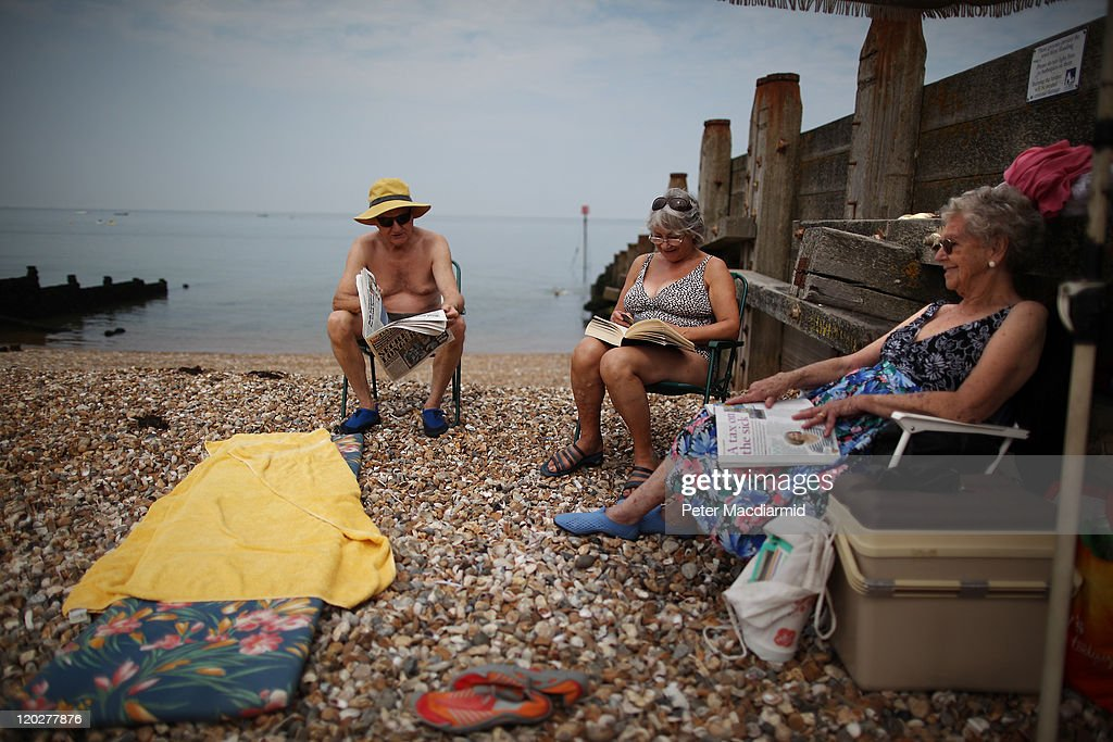 The Perry family sit on the beach on August 3, 2011 in Whitstable, England. Parts of southern England are experiencing high summer temperatures.