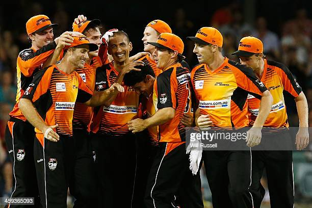 The Perth Scorchers celebrate after winning the Big Bash League match between the Perth Scorchers and the Melbourne Renegades at WACA on December 26...