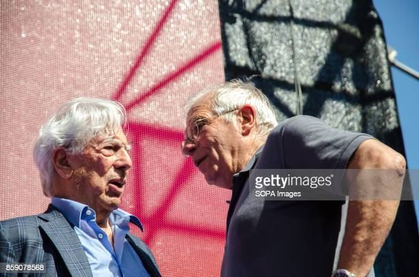 The Peruvian writer Vargas Llosa talks with the former Socialist Ministers Josep Borrell on stage Massive demonstration in Barcelona in defense of...