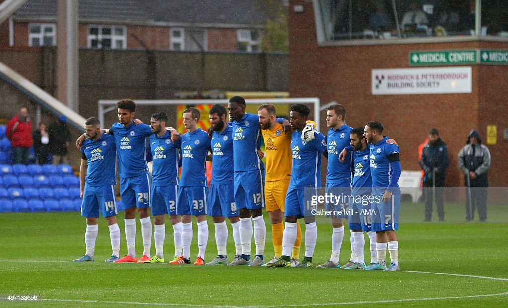 The Peterborough United team line up for a minutes silence for last nights terror attack in Paris before the Sky Bet League One match between Peterborough United and Fleetwood Town at London Road Stadium on November 14, 2015 in Peterborough, England.
