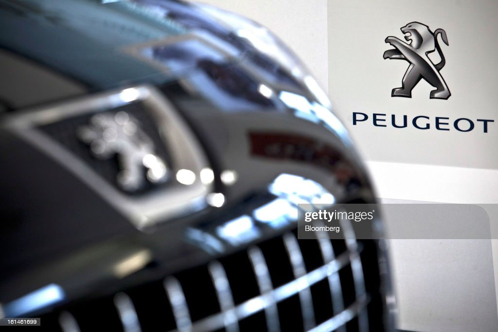 The Peugeot emblem, part of the PSA Peugeot Citroen group is seen on a display panel inside the showroom at the Peugeot Sial Toulouse dealership in Toulouse, France, on Monday, Feb. 11, 2013. Europe's car market is forecast to drop to 12.3 million vehicles this year, 23 percent below the pre-crisis peak, IHS Automotive research company estimates. Photographer: Balint Porneczi/Bloomberg via Getty Images