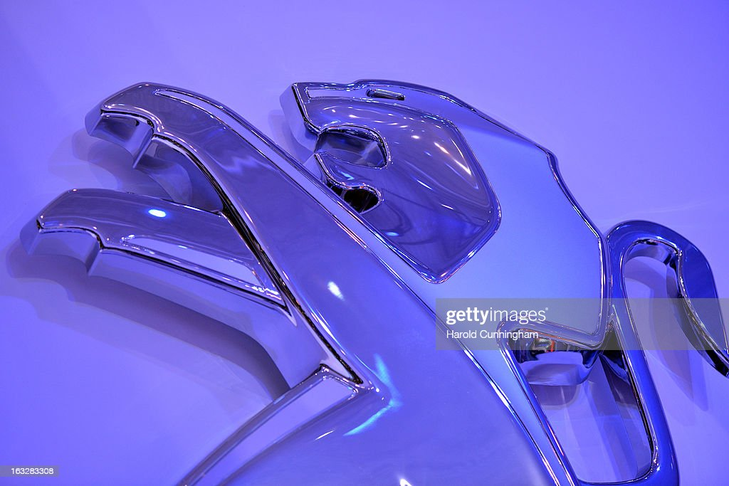 The Peugeot logo is seen during the 83rd Geneva Motor Show on March 6, 2013 in Geneva, Switzerland. Held annually with more than 130 product premiers from the auto industry unveiled this year, the Geneva Motor Show is one of the world's five most important auto shows.