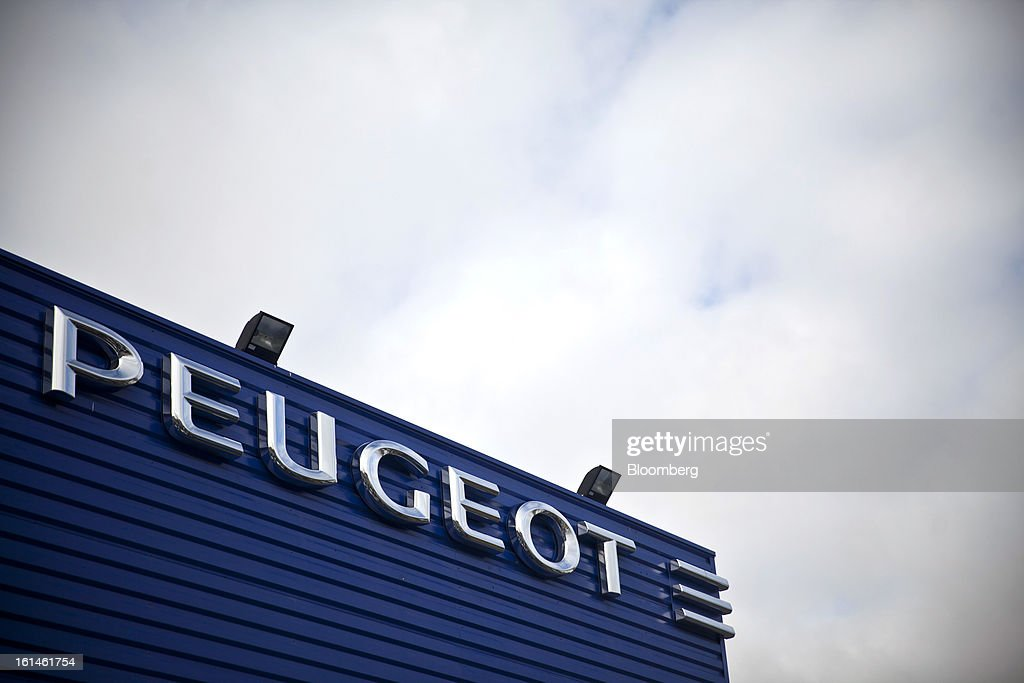 The Peugeot logo, part of the PSA Peugeot Citroen group, is seen on the exterior of the Peugeot Sial Toulouse dealership in Toulouse, France, on Monday, Feb. 11, 2013. Europe's car market is forecast to drop to 12.3 million vehicles this year, 23 percent below the pre-crisis peak, IHS Automotive research company estimates. Photographer: Balint Porneczi/Bloomberg via Getty Images