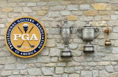 The PGA logo and trophy plaques are seen on the club house during the afternoon fourball matches on day two of the 2008 Ryder Cup at Valhalla Golf...