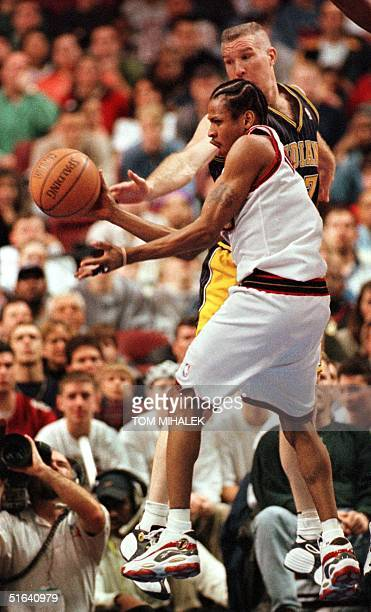 The Philadelphia 76ers Allen Iverson attempts to make a layup as the Indiana Pacers Chris Mullin tries to stop him during the game 22 February in...