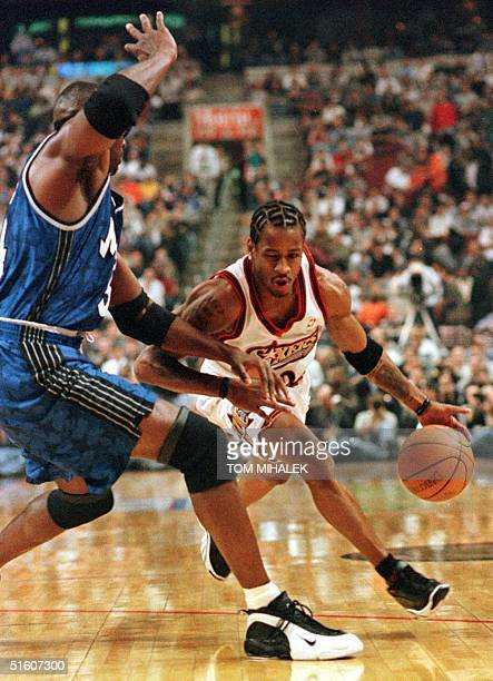 The Philadelphia 76ers Allen Iverson drives around the Orlando Magic's Horace Grant in the opening minutes of the first period of game three in the...