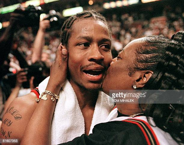 The Philadelphia 76ers' Allen Iverson gets a kiss from his mother Ann following the teams' 10191 victory over the Orlando Magic 15 May 1999 in...