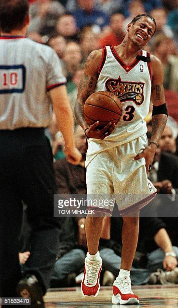 The Philadelphia 76ers' Allen Iverson holds his leg following a collision under the basket in the second period 08 November 1999 against the Seattle...