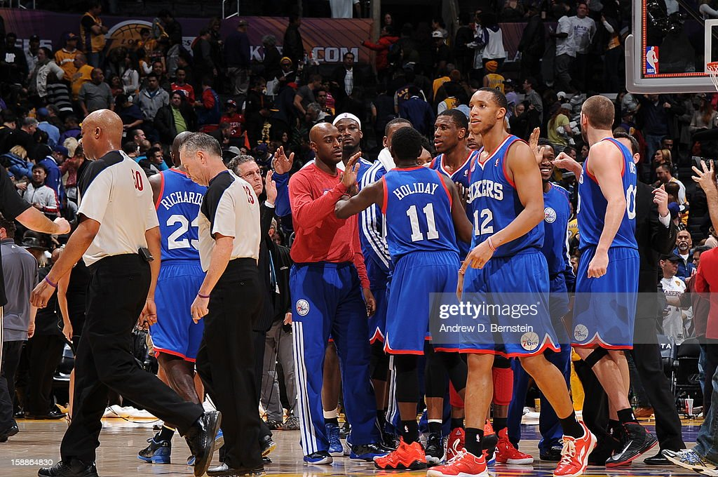 The Philadelphia 76ers celebrate their victory over the Los Angeles Lakers at Staples Center on January 1, 2013 in Los Angeles, California.