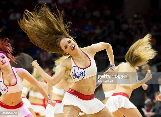 The Philadelphia 76ers dance perform during a timeout in the game against the New York Knicks on January 21 2015 at the Wells Fargo Center in...