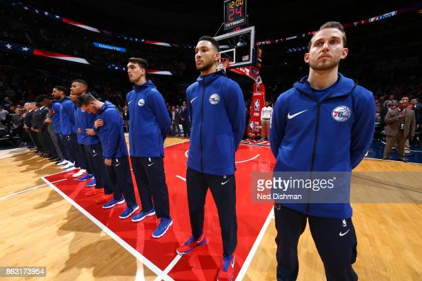 The Philadelphia 76ers during the national anthem before the game against the Washington Wizards on October 18 2017 at Capital One Arena in...